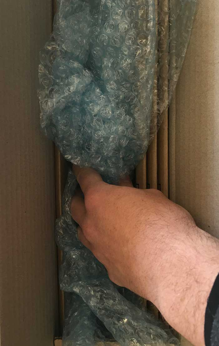 How To Safely Package Your Painting - Making sure the painting is secure